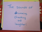 The sounds of drumming, chanting and laughter.