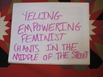 Yelling empowering feminist chants in the middle of the street.