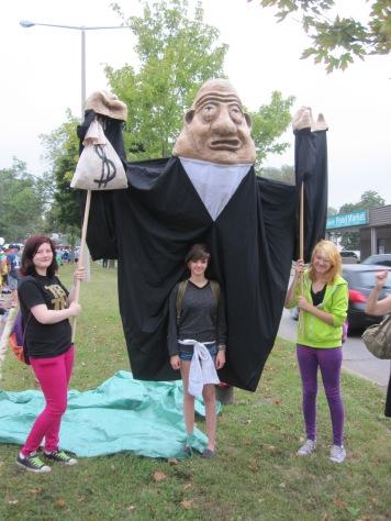 SACHA volunteers with Mr. Moneybags created by Melanie Skene of Many Hands Art