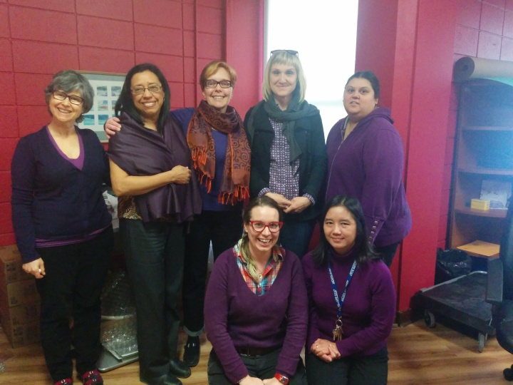 sacha staff wearing purple