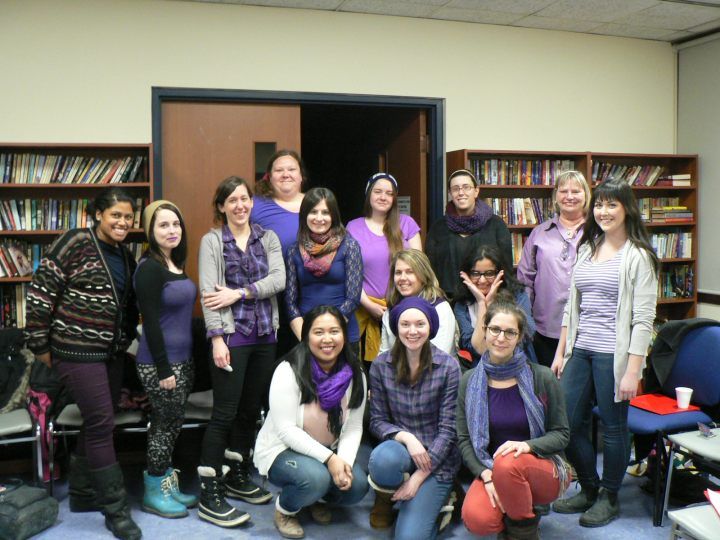 sacha volunteers wear purple